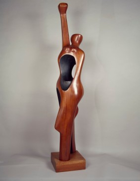 Elizabeth Catlett (American, 1915â??2012). Homage to My Young Black Sisters, 1968. Cedar, 68 x 12 x 12 in. (172.7 x 30.5 x 30.5 cm). Collection of Reginald and Aliya Browne. © Catlett Mora Family Trust / Licensed by VAGA, New York, NY. Photo: Erwin Gaspin The image may only be used for editorial content related to the exhibition, including reviews, in the interior of the print or online publication. The copyright credit line must appear directly below or adjacent to all reproductions. Except for critical reviews, no images may be reproduced after the closing of the exhibition unless authorized in writing by VAGA. Except for critical reviews, all online reproductions shall be removed at the conclusion of the exhibition. If reproduced on the web, the reproduction shall be a maximum of 72 dpi with a dimension of no more than 1000 pixels on the longest side. The copyright credit line must be underlined or highlighted to create a link to www.vagarights.com.